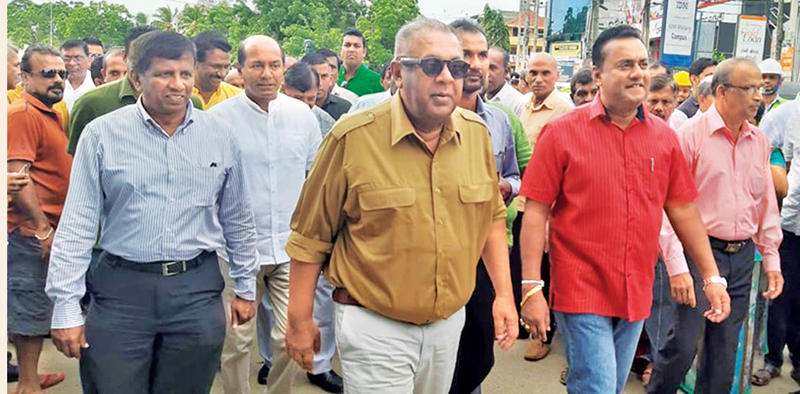 Finance Minister Mangala Samaraweera at the  inauguration of the Hakmana road-widening project.  Picture by Gandara Group Corr.