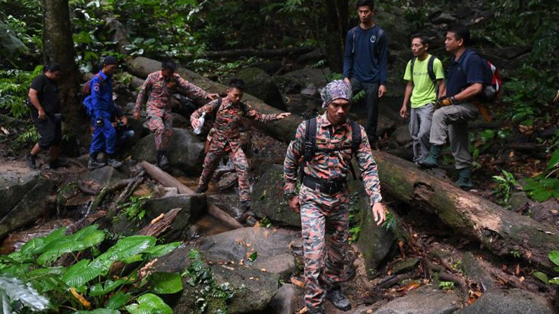 Rescuers conduct a search and rescue operation for a missing British girl at a forest in Seremban.