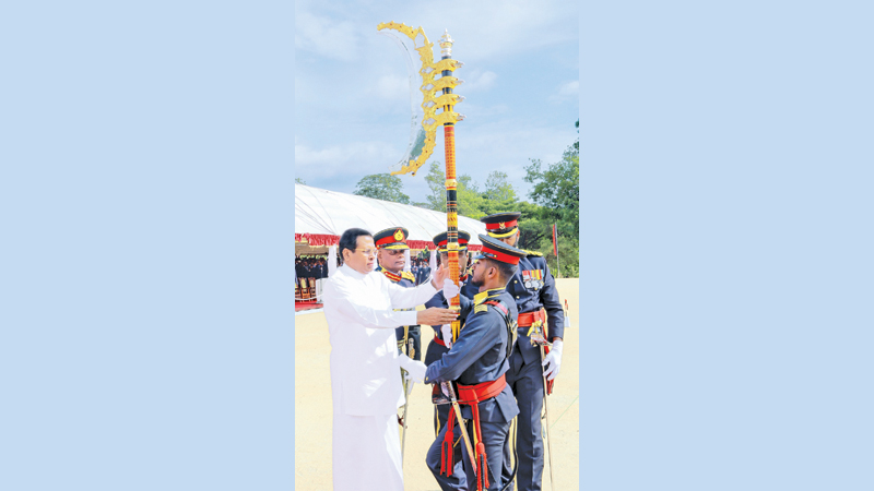President Maithripala Sirisena presenting colours at the Regimental and Presidential Colours ceremony of the elite Special Forces Regiment of the Army in Naula yesterday. Picture by Kapila Ariyawansa- President's Media Unit