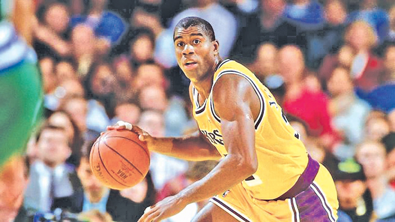 Magic Johnson in action as captain of his beloved LA Lakers.