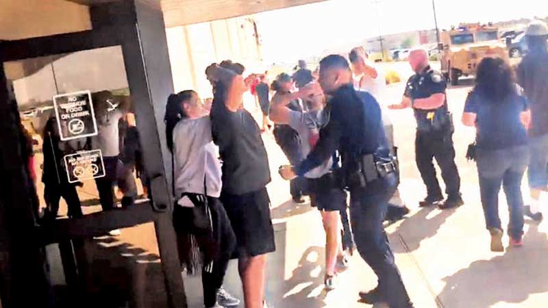 People are bodily checked at the Cinergy cinema following the shooting in Odessa in this still image from a social media video.
