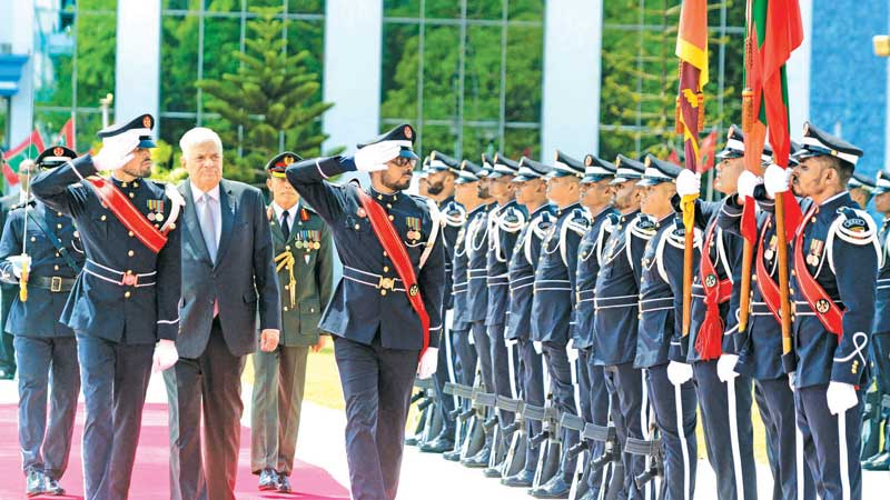 Prime Minister Ranil Wickremesinghe who is on a three day official visit to the Maldives on the invitation of Maldivian President Ibrahim Mohamed Solih inspecting a ceremonial Guard of Honour at the Rupublic Square yesterday. Picture courtesy Prime Minister's Media