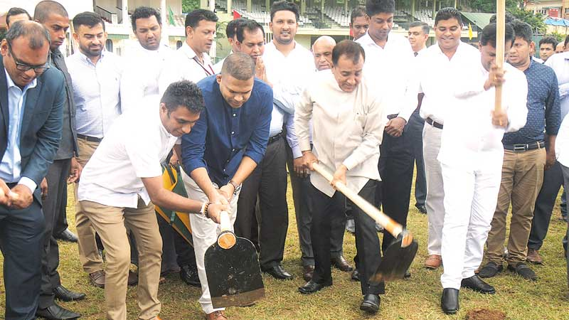 Sports Minister Harin Fernando (blue shirt) cuts the first sod to inaugurate the Bogambara Stadium synthetic track with Cabinet Minister Lucky Jayawardena.