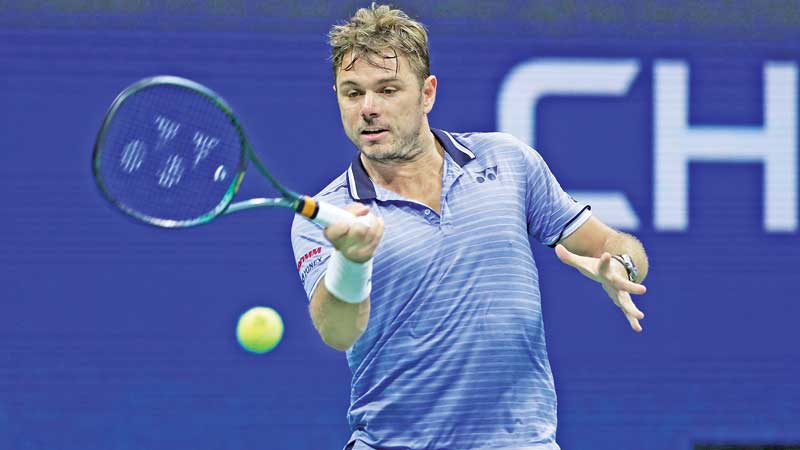 Stan Wawrinka of Switzerland returns a shot during his Men's Singles fourth round match against Novak Djokovic of Serbia on day seven of the 2019 US Open on September 01. AFP