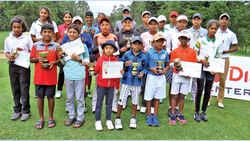 Winners with their trophies and certificates