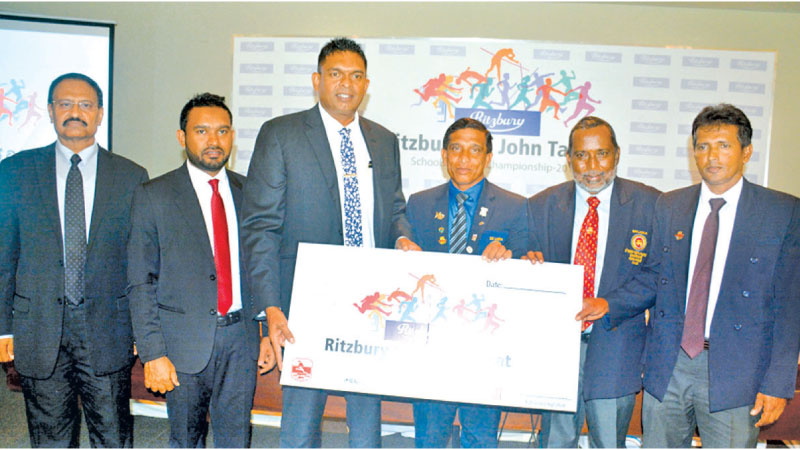 The sponsorship cheque being handed over by General Manager- Marketing, CBL Foods International Nilupul de Silva (third from left) to President of Sri Lanka Schools Athletic Association Upali Amaratunga (fourth from left). Also in the picture are (from left) Public Relations Manager – CBLF Janaka Boteju, Brand Manager – CBLF Aruna Liyanapathirana, Treasurer of SLSAA Jayalal Ratnasooriya and Secretary of SLSAA Neville Rodrigo.  Picture by Ranjith Asanka