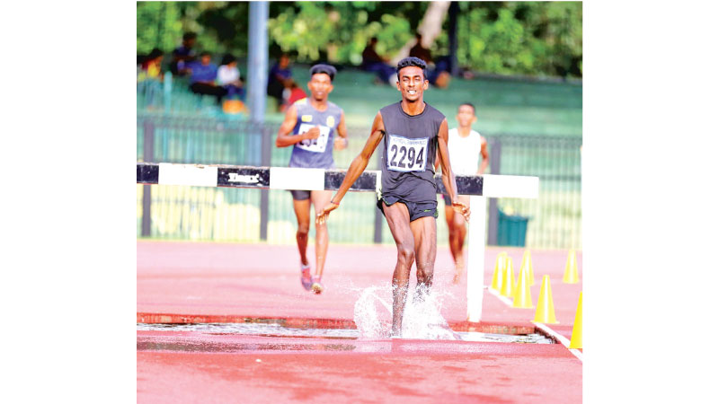 The Boys Steeple chase winner P.R.Galadeniya of Kegalu Vidyalaya in action. Picture by  Sulochana Gamage