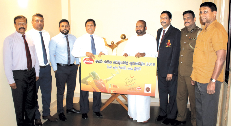 Nalin B  Karunaratne, Chief Executive Officer of Ceylon Biscuits Limited (fourth from left) presenting the sponsorship for the Munchee National Volleyball Championship 2019 to Ranjith Siyambalapitya, MP and president of Sri Lanka Volleyball Federation (SLVF), flanked by officials from Munchee and SLVF.