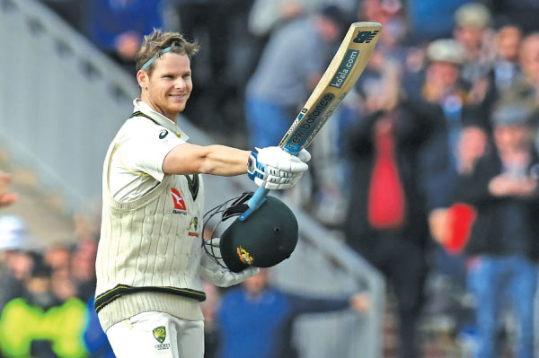 Australia's Steve Smith celebrates after reaching 200 during play on the second day of the fourth Ashes Test against England at Old Trafford in Manchester, north-west England yesterday. - AFP