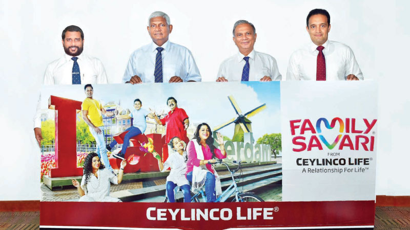 Ceylinco Life Chairman R. Renganathan and Managing Director Thushara Ranasinghe with the Company's General Manager Marketing Samitha Hemachandra and Brand Manager Marketing Chamath Alwis at the launch of the latest Family Savari promotion.