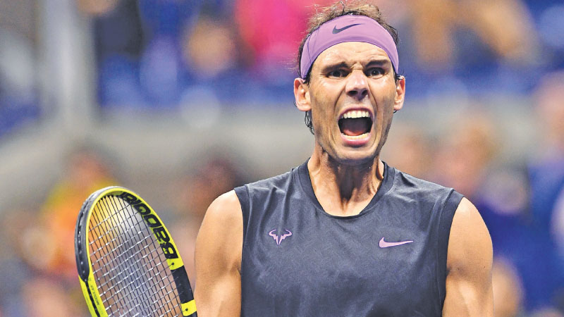 Rafael Nadal of Spain reacts after winning against Diego Schwartzman of Argentina during their Men's Singles Quarter-finals match at the 2019 US Open at the USTA Billie Jean King National Tennis Center in New York on September 4. -AFP