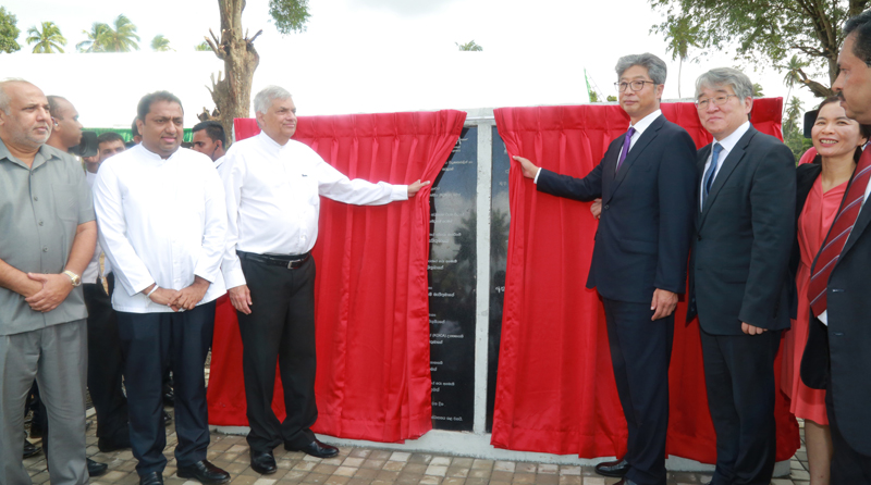 Prime Minister Ranil Wickremesinghe and Korean Ambassador in Colombo  Heon Lee along with other officials unveil the plaque to mark the foundation stone laying for the National College of Education and Teacher Training System for Technology in Kuliyapitiya.