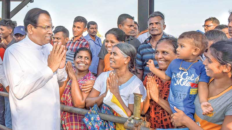 President Maithripala Sirisena speaks to people of the Mahaweli farmer community who were spectators at the Mahaweli Games in Bisopura, Medirigiriya, on Sunday. Picture courtesy President's Media Division