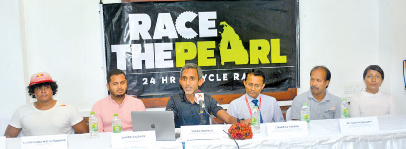 The Director of 'Race the Pearl' Yasas Hewage (third from left) speaking at a media briefing held at Spinner Cycling Lifestyle Centre, Madiwela yesterday. Also in the picture are (from left) Red Bull Athlete Sudarshana Muthuthanthri,Operations Manager of Jetwing Hotels Ltd Dimitry Cooray, Director/ChiefOperating Officer, Stafford Motors Charaka Perera, Head of Rehabilitation-MJFCharitable Foundation Dr. Gopi Kitnasamy, and Spinner Cycling Lifestyle Centre's Ajani Hewage.  Picture by Ranjith Asanka