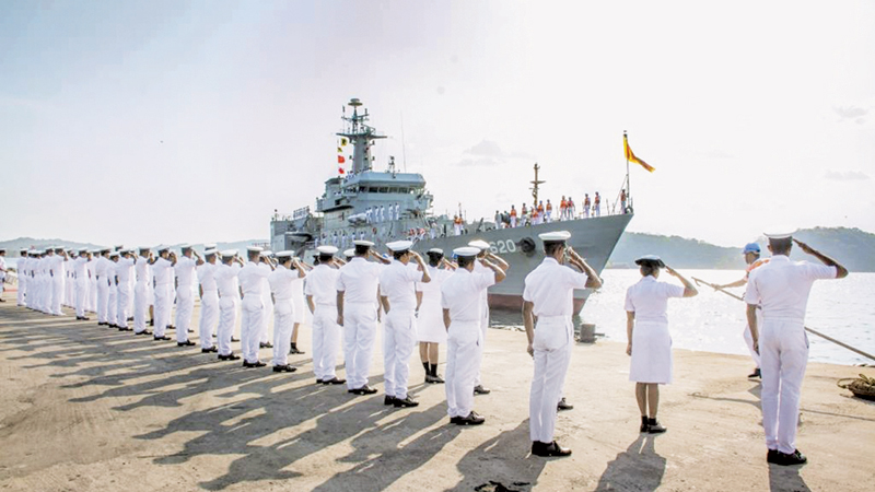 Naval personnel welcoming the returning ships.