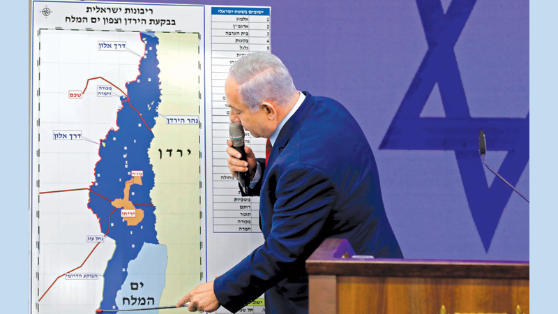 Israeli Prime Minister Benjamin Netanyahu points at a map of the Jordan Valley as he gives a statement in Ramat Gan, near the Israeli coastal city of Tel Aviv, on Tuesday. - AFP