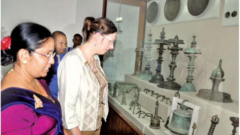 United States Ambassador Alaina B. Teplitz who re-opened the Anuradhapura Archaeology museum  on Thursday is seen inspecting some of the items of great historical and archaeological value on display. Picture by Nimal Wijesinghe, Anuradhapura Additional District Group