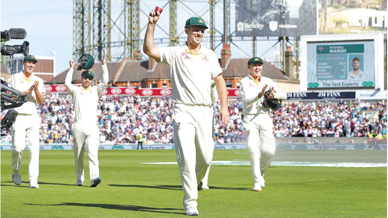Mitch Marsh of Australia celebrates his his 5 wicket haul on the second day of the fifth and final Test against England at the Oval on Friday.
