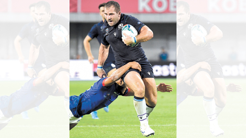 Scotland's hooker Fraser Brown runs with the ball during the Japan 2019 Rugby World Cup Pool A match between Scotland and Samoa at the Kobe Misaki Stadium in Kobe on September 30. AFP