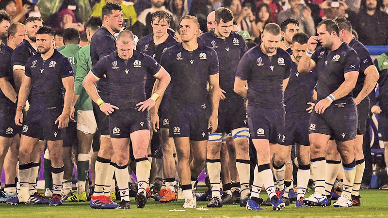 Scotland players look dejected after the Rugby World Cup Pool A defeat against Ireland at International Stadium Yokohama, Japan.