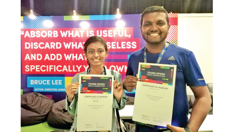 Dinali and Hansaka with their Gold award certificates for winning the 'Media' category