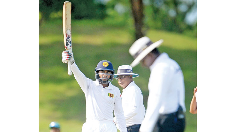 Sri Lanka A's Kamindu Mendis celebrates his century on the third and final day of the first unofficial test against Bangladesh A at Hambantota yesterday.