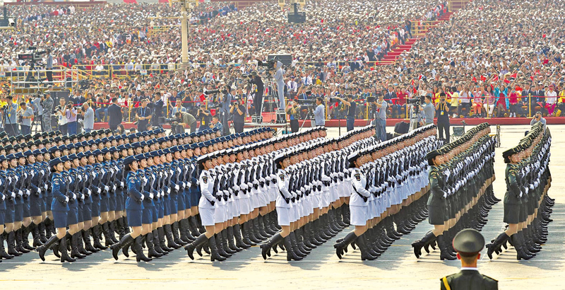 Members of a Chinese military honour guard march during the celebration to commemorate the 70th anniversary of the founding of Communist China.