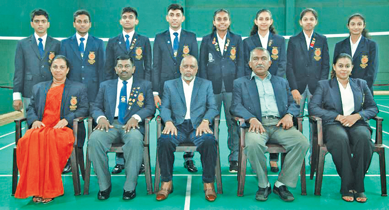 The Sri Lanka junior badminton team members with Sri Lanka badminton President Rohan de Silva (front row centre) prior to their departure for Kazan, Russia. From front row left: Lady chaperon Malika Waduge, Manager of the team Saman Wijesinghe, coach Thilini Jayasinghe (right extreme) and (second right) SLB Vice President Palitha Hettiarachchi.