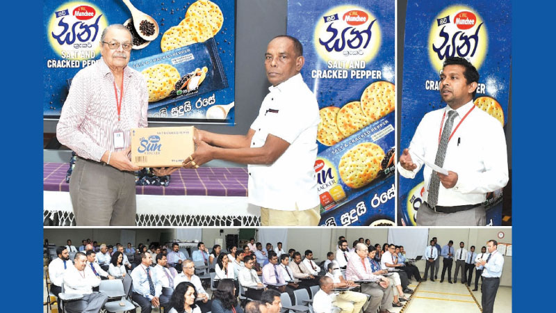 Ramya Wickramasingha, Chairman, Ceylon Biscuits Limited presents the first consignment of the Munchee new Sun Cracker Salt, Cracked Pepper to C. Kumarage, Munchee distributor for Homagama.  Anuradha Mahesh, Brand Manager for Munchee cracker ranges at the Event.