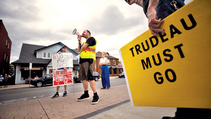 Protesters demonstrate against a campaign visit by Canadian Prime Minister Justin Trudeau in Stoney Creek, Ontario, on September 29, 2019.