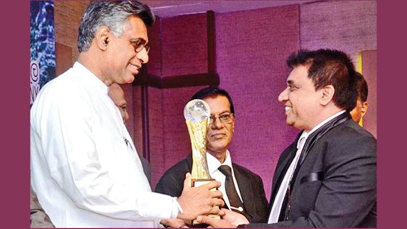 Managing Director of International Medical Care  Ranjith Susantha Karunaratne receives the award from Minister Patali Champika Ranawaka