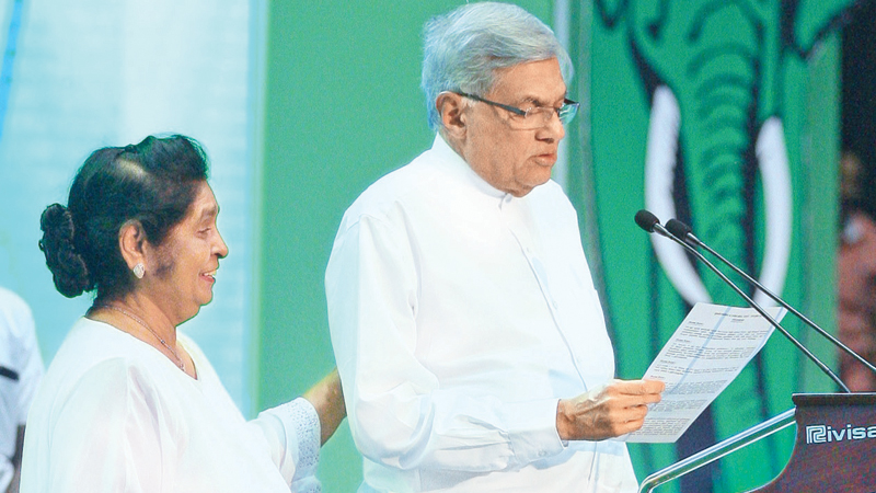 Prime Minister Ranil Wickremesinghe proposing UNP Deputy Leader Sajith Premadasa as the Presidential Candidate of the United National Front at yesterday's special UNP convention in Colombo. Former First Lady Hema Premadasa was also present. Pictures by Hirantha Gunathilaka.
