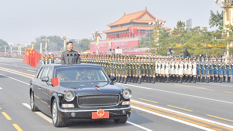 Chinese President Xi Jinping at a review of troops from a car during a military parade at Tiananmen Square in Beijing on October 1, 2019, to mark the 70th anniversary of the founding of the People's Republic of China. - XINHUA