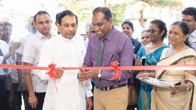 Minister Rajitha Senaratne along with other officials opens the new Osu Sala outlet in Matugama.