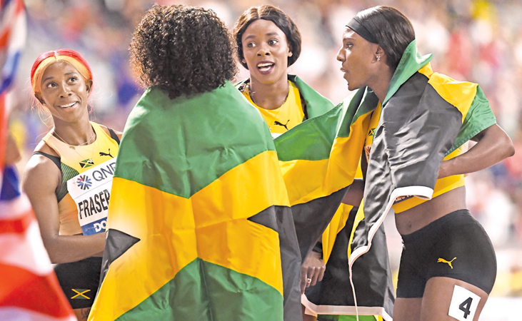 (From L to R) Jamaica's Shelly-Ann Fraser-Pryce, Natalliah Whyte, Shericka Jackson and Jonielle Smith celebrate after winning the Women's 4x100m Relay final at the 2019 IAAF Athletics World Championships at the Khalifa International stadium in Doha on October 5, 2019.  AFP