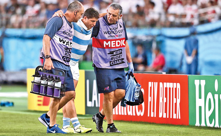 Argentina's Tomas Cubelli leaves the pitch after sustaining an injury.