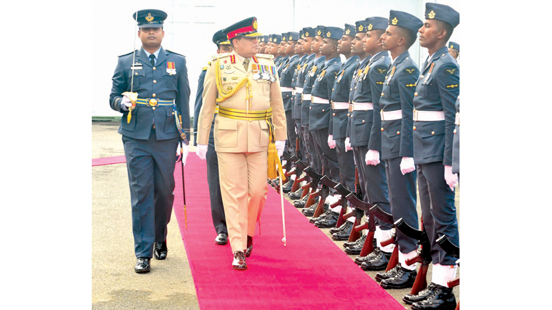 Army Commander Lieutenant General Shavendra Silva inspects the guard of honour at the SLAF Headquarters yesterday.
