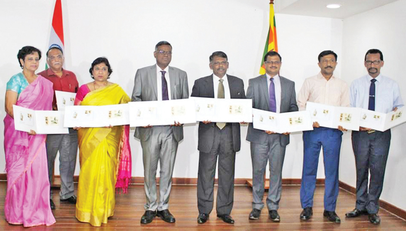 Sri Lanka Deputy High Commissioner, Chennai, V. Krishnamoorthy and other officials with the albums consisting of the first-day cover and the stamps issued by the Sri Lanka Post on October 2.