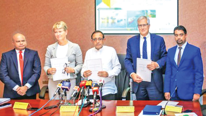 Minister of Highways and Road Development and Petroleum Resources Development Kabir Hashim and the officials of Total and Equinor after signing the agreement last month