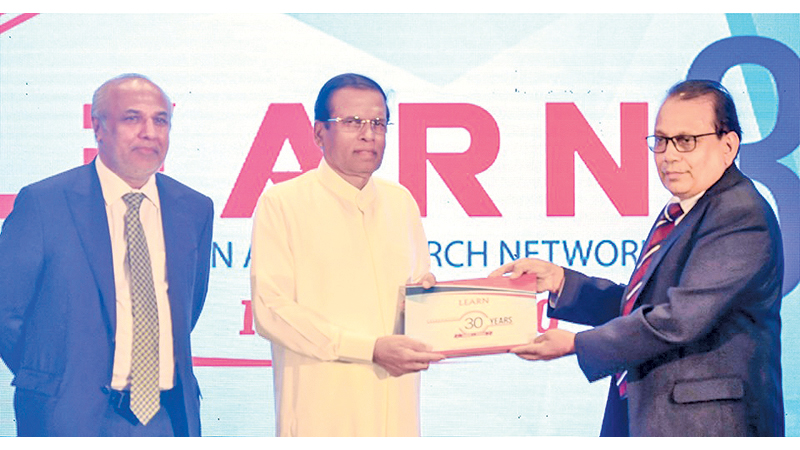 President Maithripala Sirisena, Minister Rauff Hakeem and Prof. Abhaya Induruwa, the founder of LEARN, at the event. Picture courtesy President's Media Divisin