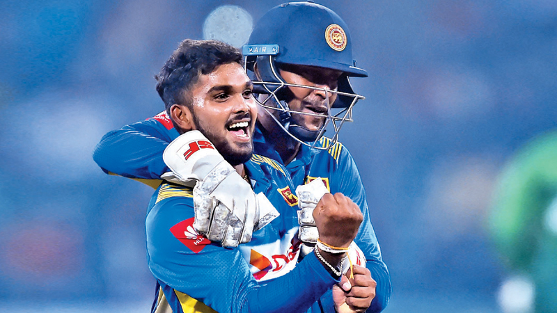 Sri Lanka's spinner Wanindu Hasaranga (L) celebrates with wicketkeeper Minod Bhanuka after the dismissal of Pakistan's captain Sarfraz Ahmed during the second Twenty20 International cricket match between Pakistan and Sri Lanka at the Gaddafi Cricket Stadium in Lahore on October 7. AFP