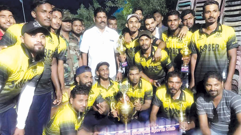 The victorious Addalaichenai Sober SC team with their trophies and cash prize.