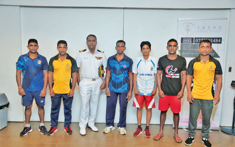 The Sri Lanka Defense Services team for the Military World Games (from left): D.L.P.R. Kumara, B.G.L. Kumara (head coach), Cdr. M.A.L. Perera (Manager), P.K. Amaratunga (assistant coach), Sajeewani Cooray, R.W.M.S.B. Rajakaruna and N.B.A.J. Vimukth Kumara. Picture by Shan Rambukwella