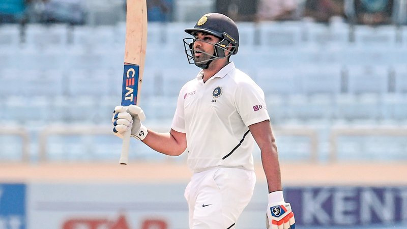 Rohit Sharma celebrates his 200 runs during the second day of the third and final Test match between India and South Africa at the Jharkhand State Cricket Association (JSCA) stadium on Sunday.