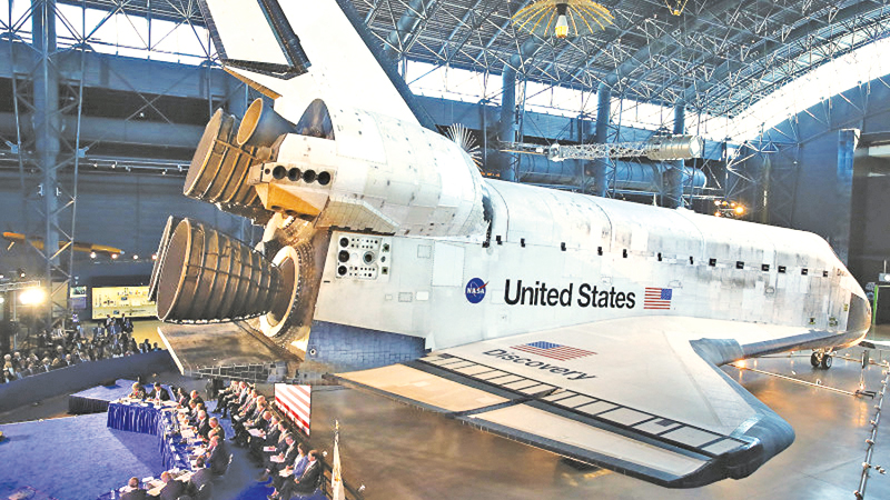 "The Space Shuttle Discovery is the back drop as U.S. Vice President Mike Pence chairs the 6th meeting of the National Space Council on ""Leading the Next Frontier"" at the National Air and Space Museum, Steven F. Udvar-Hazy Center, August 20, 2019 in Chantilly, Virginia."