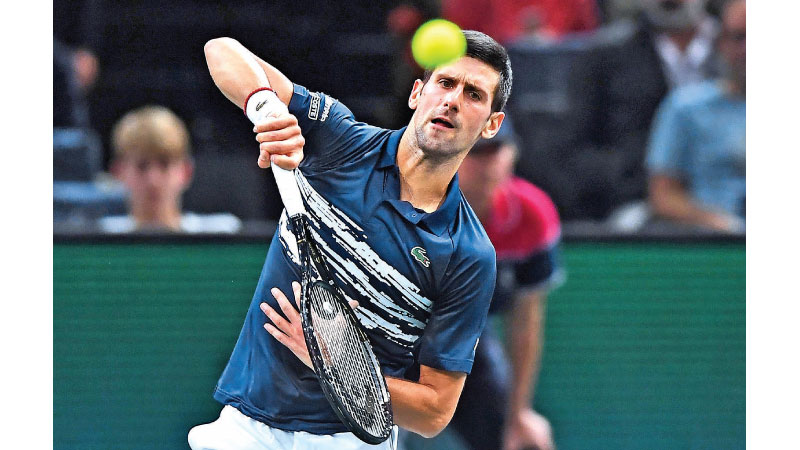 Novak Djokovic returns the ball to France's Corentin Moutet during their men's singles tennis match on day three of the ATP World Tour Masters 1000 - Rolex Paris Masters - indoor tennis tournament at The AccorHotels Arena in Paris on October 30. AFP