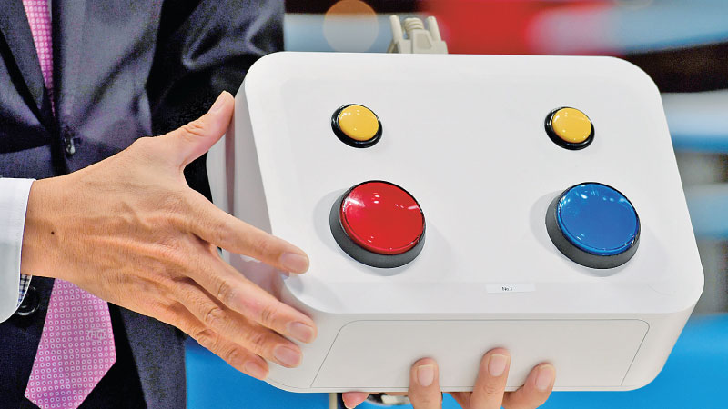 A console of a new judge monitoring system is introduced to media during a boxing test event at the Kokugikan Arena, a venue for the Tokyo 2020 Olympic Games, in Tokyo yesterday. - AFP