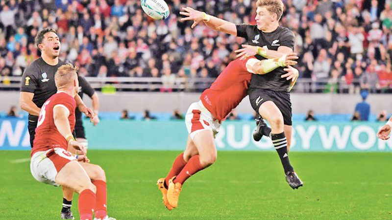 New Zealand fullback Beauden Barrett (R) was in the thick of the action. AFP