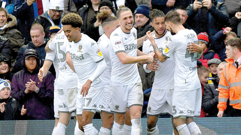 Tyler Roberts celebrates his first start of the season by putting Leeds back on top of the Championship with a 2-0 win over QPR.