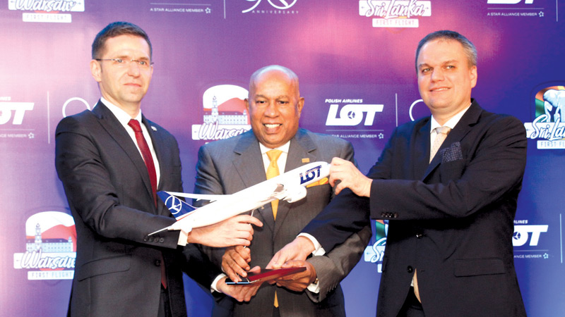 Chief Commercial Officer, Member of the Board of LOT Polish Airlines Michal Fijol Adam Burakowski, Polish Ambassador accredited to Sri Lanka and Hayleys Chairman and Chief Executive Officer, Mohan Pandithage are seen here exchanging a memento to mark the commencement of direct flights between Warsaw and Colombo. Picture by-Sulochana Gamage